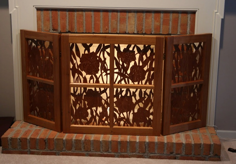 Here's an outstanding Mahogany Fireplace Screen Keith made recently. Careful cutouts are silhouetted by the light behind t he screen.