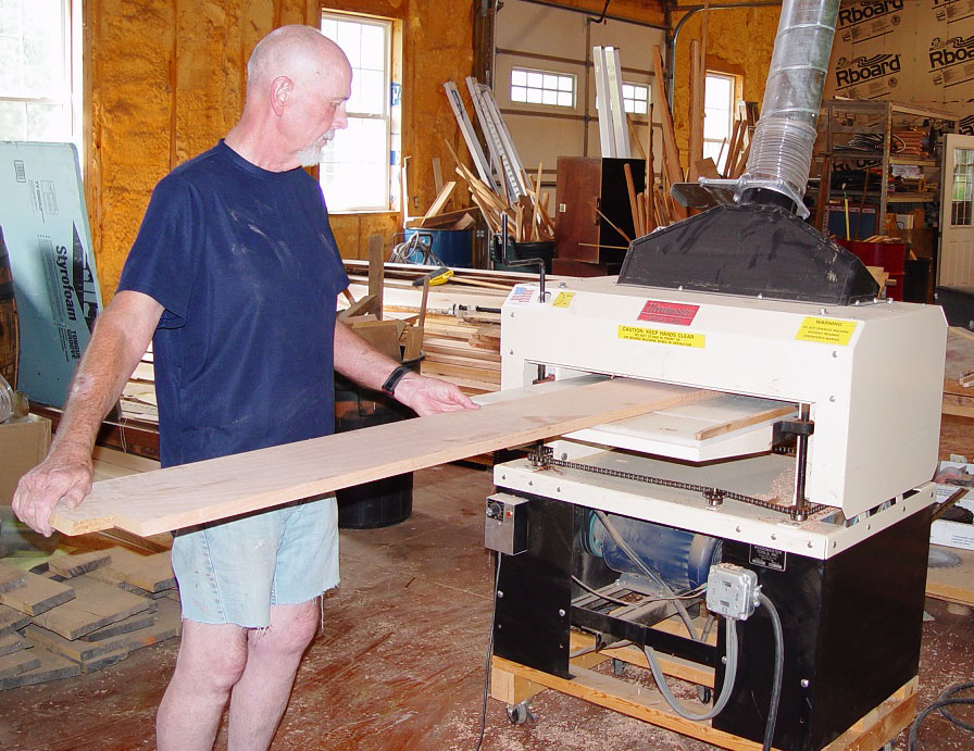 Besides his Woodmaster Drum Sander, Charles owns a Woodmaster Molder/Planer, shown here. Between these two tools, he has everything he needs to turn roughcut lumber into finished trim and molding. And that's exactly what he did.