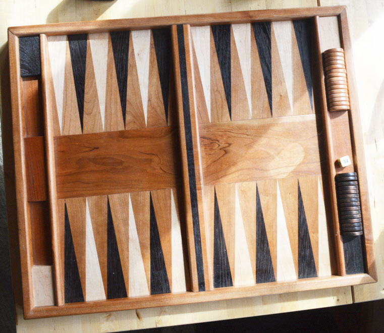 Anyone for backgammon? Commercial boards' diamond-shaped pieces are laminated to a substrate. Chuck makes his of solid wood. It takes real precision to do this kind of work!