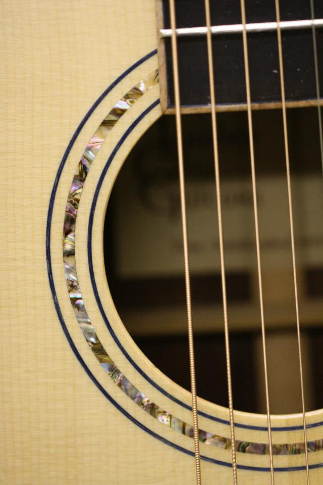 """""""This guitar has a Sitka spruce top,"""" John tells us. """"I trimmed the sound hold with Abalone shell."""""""