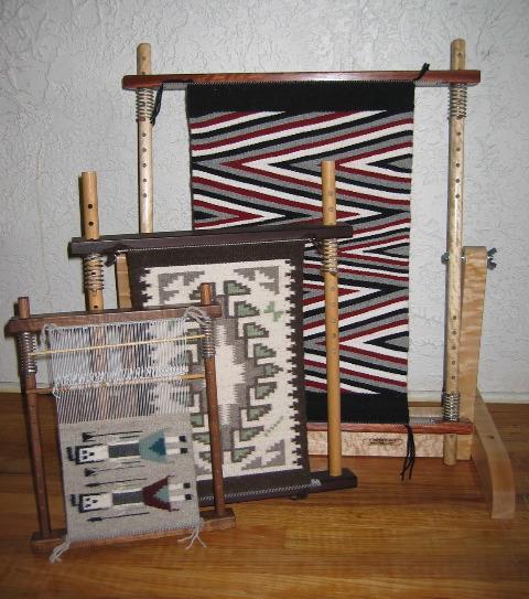 """Caroline told us, """"I designed my looms to make Navajo-style miniature rugs. I have always loved the designs found in Navajo rugs and started weaving them in the 1970's. Now my looms are used for any tapestry style weavings."""" The looms come in three sizes. The smallest is 12"""" x 15"""". The medium is 17"""" x 22"""" and the large is 27"""" x 30. I've made them in a variety of woods. The ones pictured are walnut, African padauk, and bird's eye maple."""