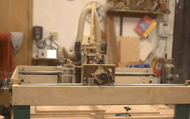 """Here's Dennis' """"Ace hardware CNC router."""" Yes, he made it himself with parts from here and there and Ace Hardware. It obviously does a great job as you can see in the intricate bas relief carvings and engraving on his plaques."""