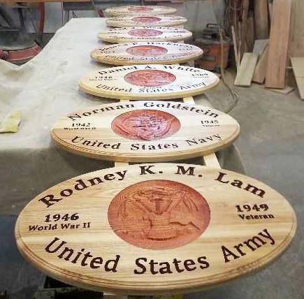 Honoring vets, Dennis has made hundreds of commemorative Service plaques. Each one takes him 8 hours or so.